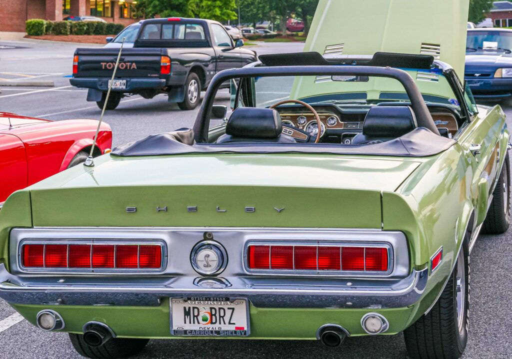 classic green ford shelby in parking lot