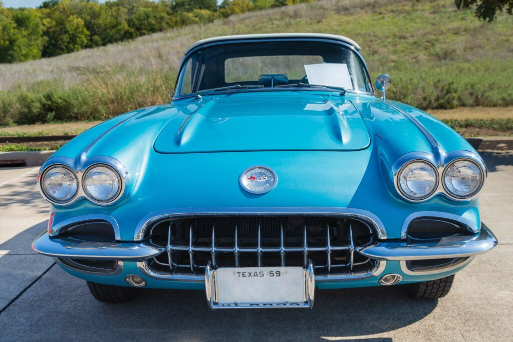 picture of classic corvette with hill in the background